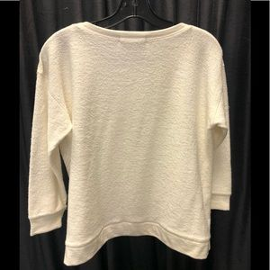 Light weight sweat shirt style pull over.